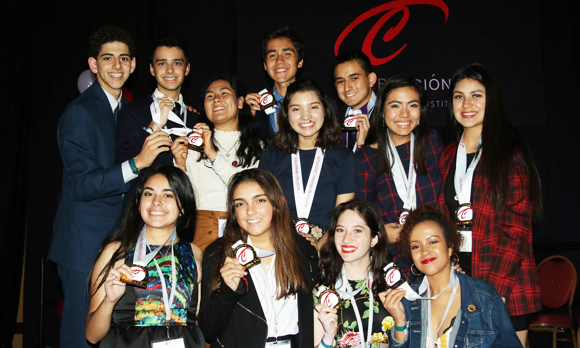 Creer Para Ver, the winning LDZ team at Celebracion 2018, poses with their first place medals.