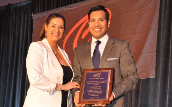 Carlos Paz, Jr. with NHI Board Chair Michelle Saenz Rodriguez at the 2015 NHI Alumni Award Ceremony
