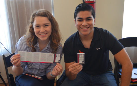 Two NHIers at 2019 PA training, showing off the new NHI Foundations cards
