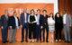 Dr. Leonard Moore of UT-Austin's DDCE presents NHI with a Community Partnership award