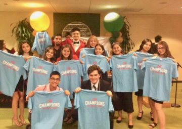 The 2019 International CWS Thought Series winners pose with shirts declaring them such