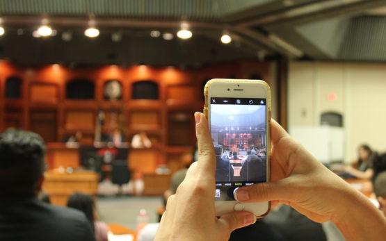 student capturing ldz on phone